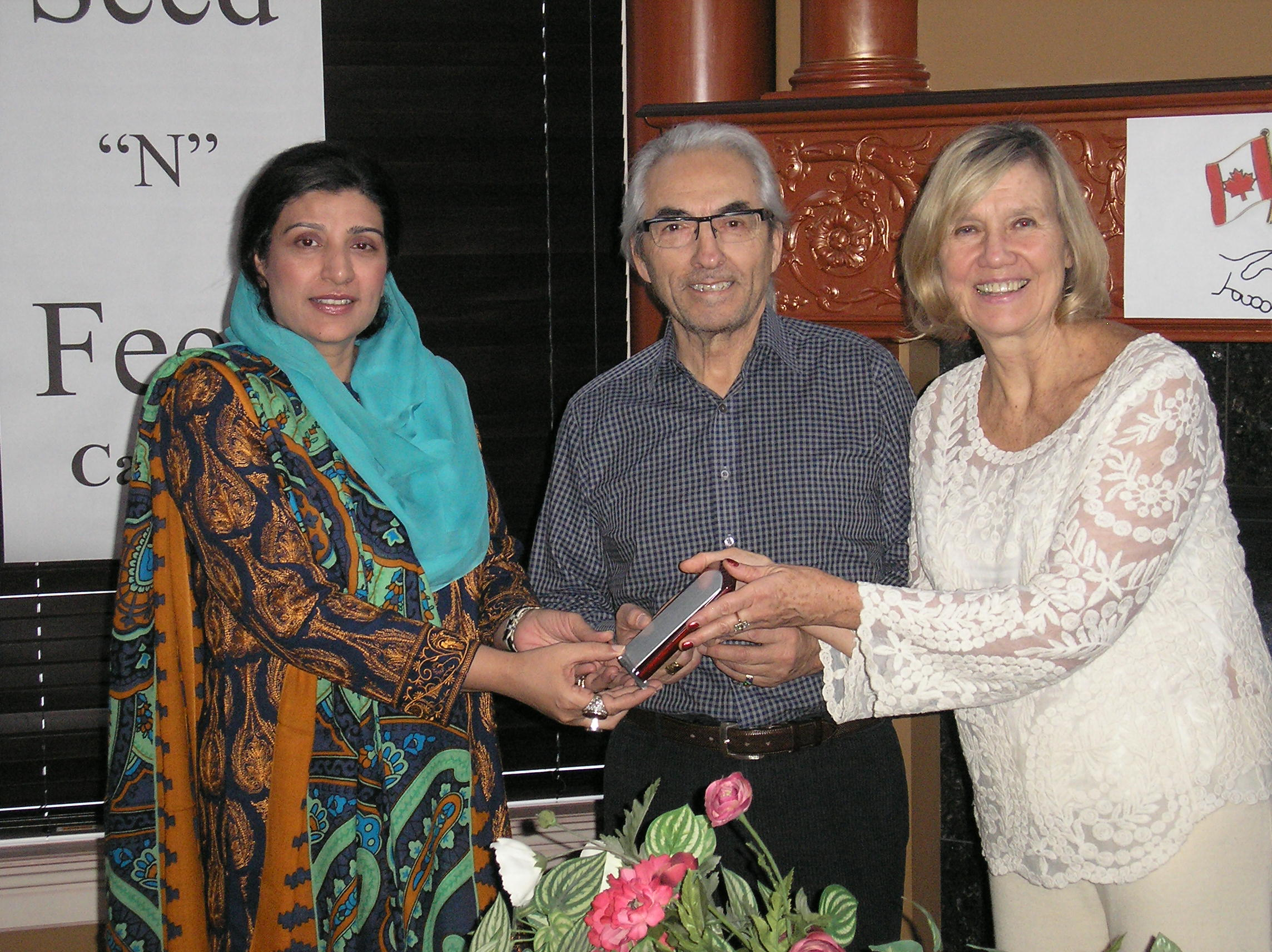 An award from Kathleen Mahoney and Phil Fontaine, the two senior directors of Seed and Feed Program. Calgary, Canada